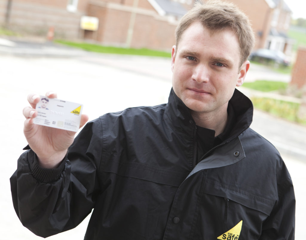 Gas safety engineer displays ID card when visiting a home